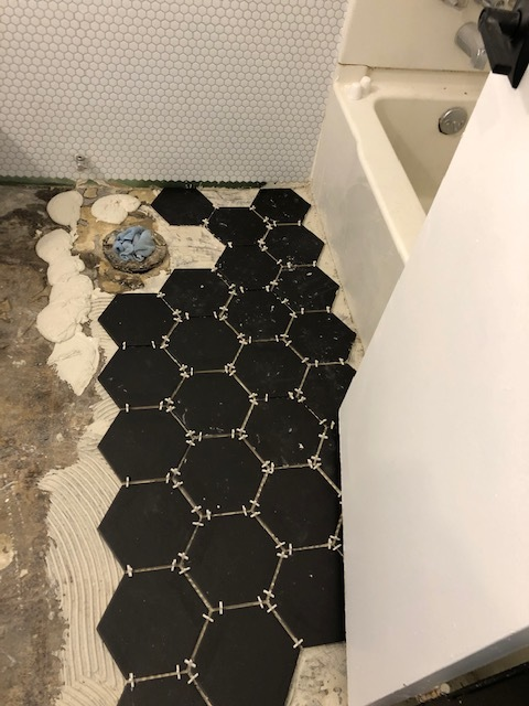 Happy to finally start on the bathroom floor! The tiles were sitting at the house for about a week before we started working on it.