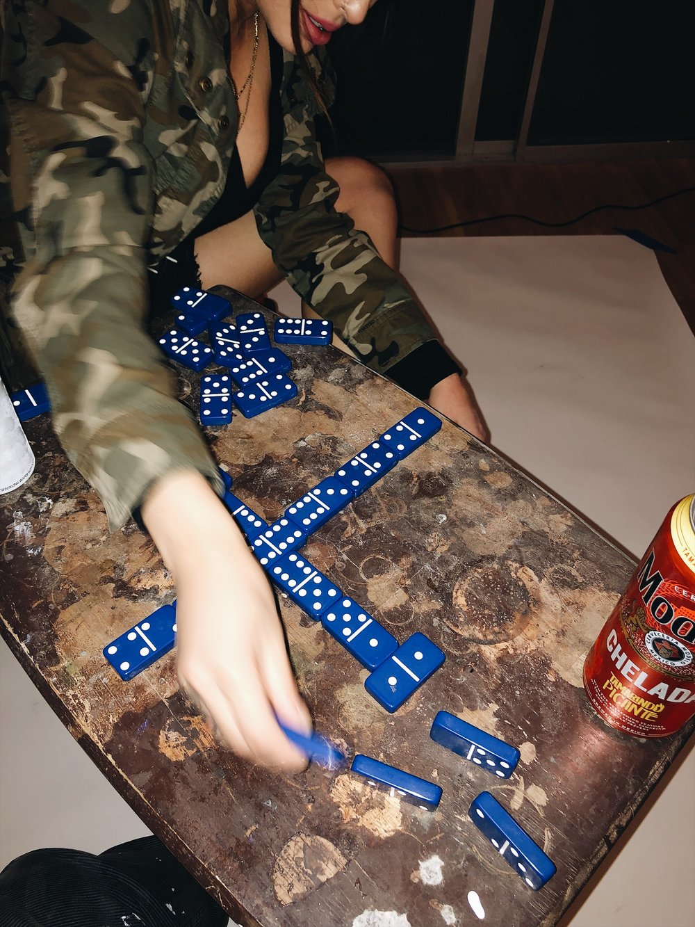 Erika taught me how to play dominos.