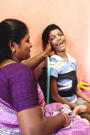 A mother supports her son during a therapy session in Hope Special School, Chennai, India.