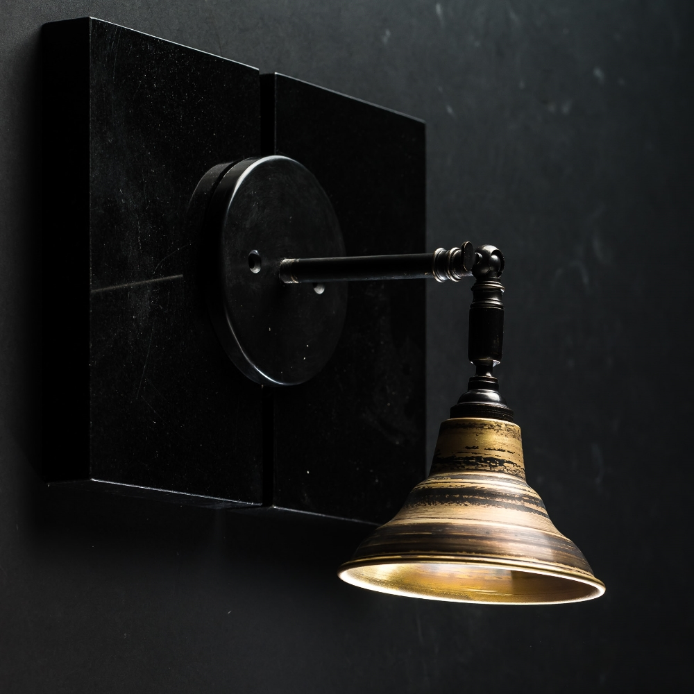 Distressed turned bronze armed wall light 01.jpg