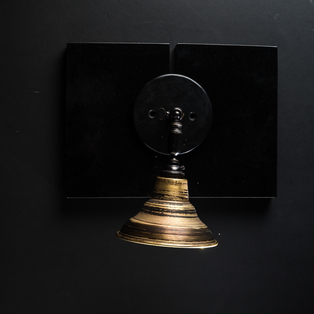 Distressed turned bronze armed wall light 02.jpg