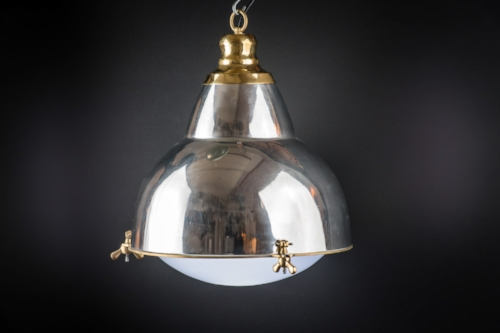 Polished steel and brass French pendant.jpg