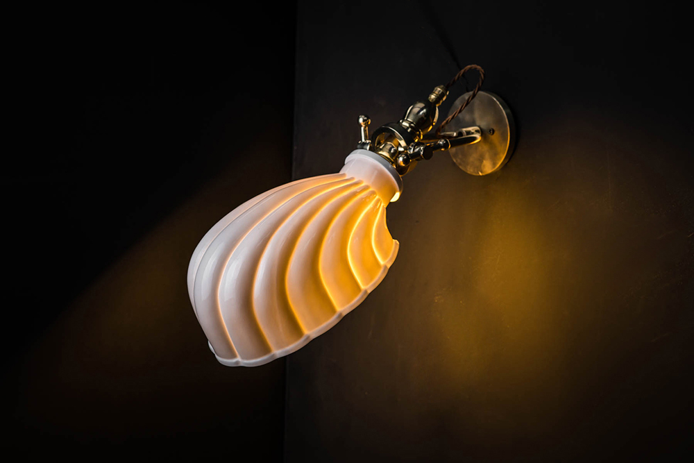 Adjustable Brass and Bone China Shell Wall Light