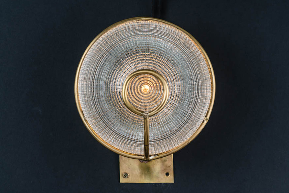 Brass and holophane glass wall sconce.jpg