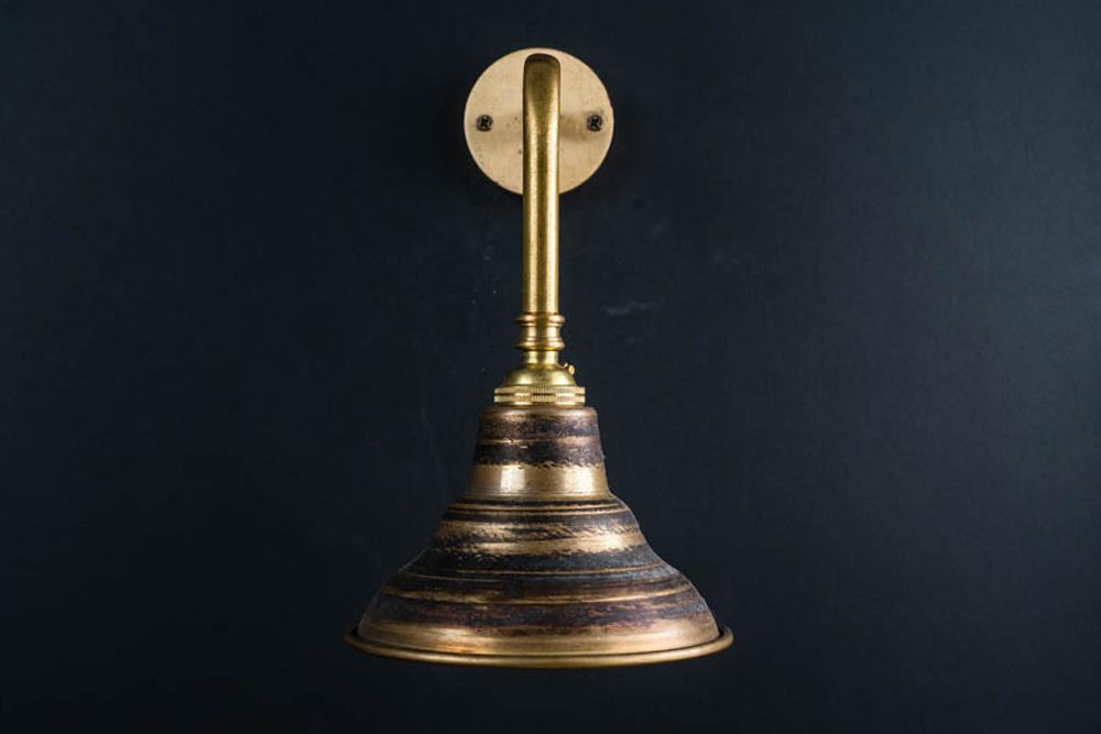 Raw brass wall light.jpg