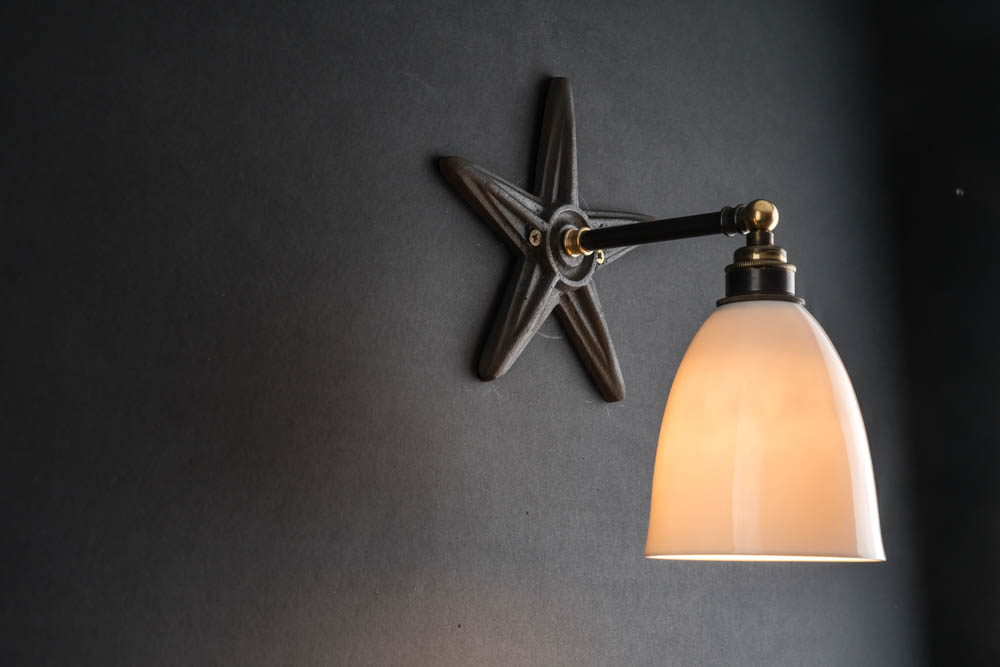 Cross tie bone china wall light.jpg