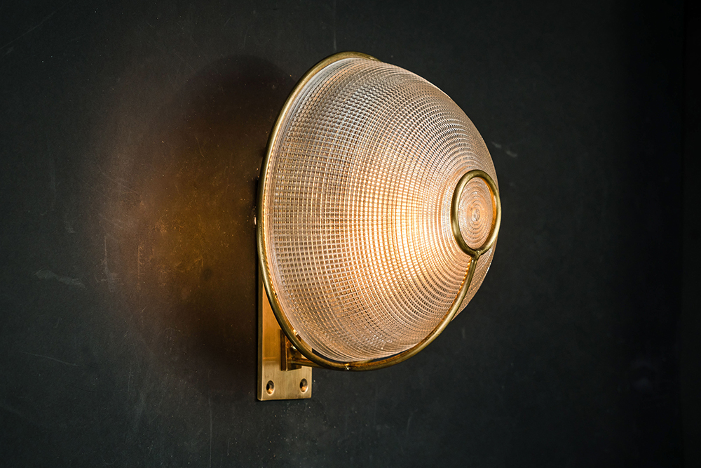 Large brass and holophane glass wall sconce.jpg