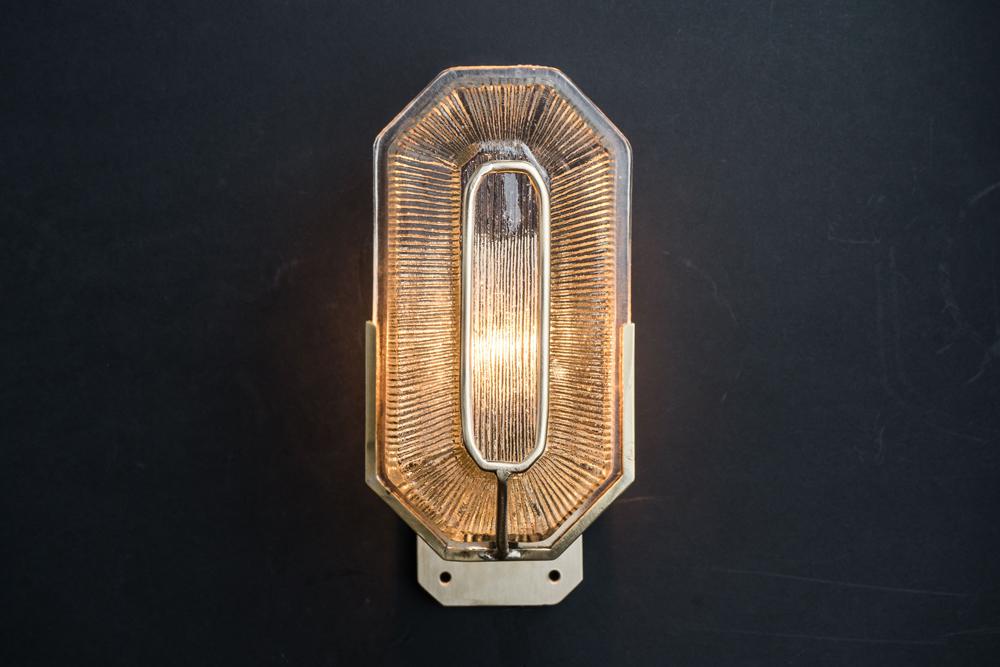 Octagonal prismatic glass and brass wall light.jpg