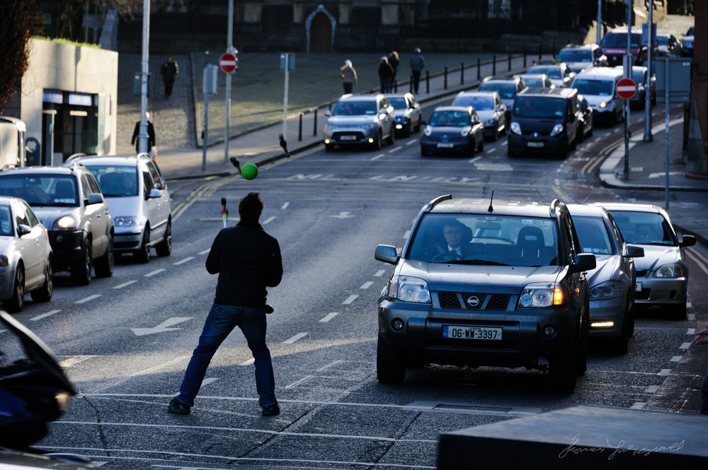 Man Juggling in traffic - A December Walk along the Liffey