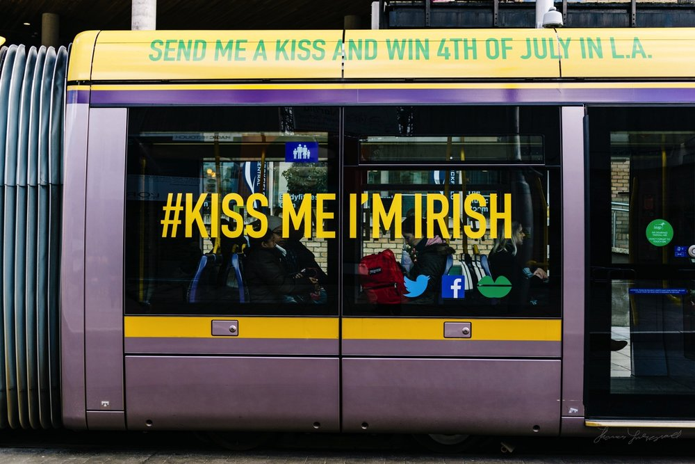 """Luas Tram with """"Kiss Me I'm Irish"""" on the side"""
