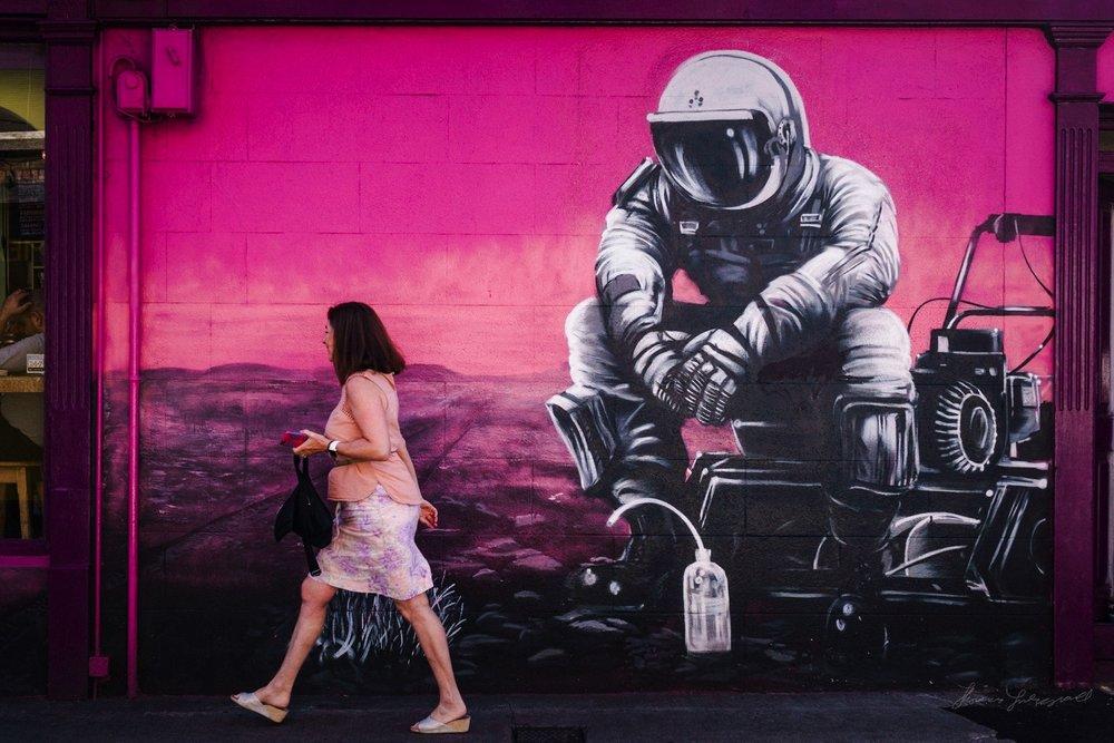 Woman walks by Street Art in Ranelagh in Dublin