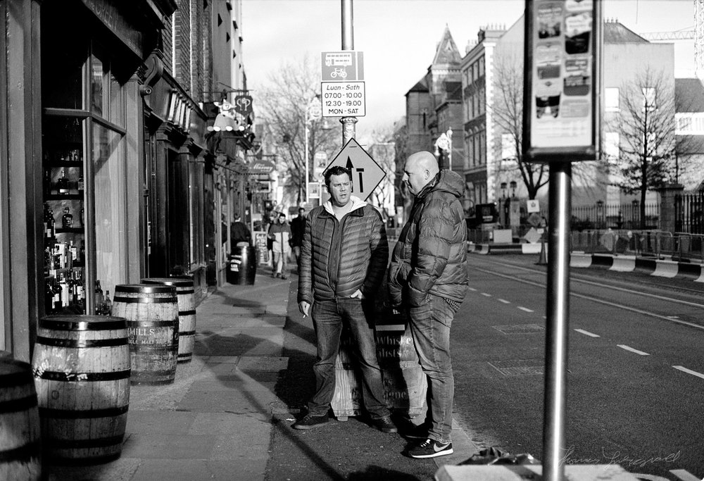 People at a Bus Stop on Dawson Street - Dublin on Film - The Streets of Dublin
