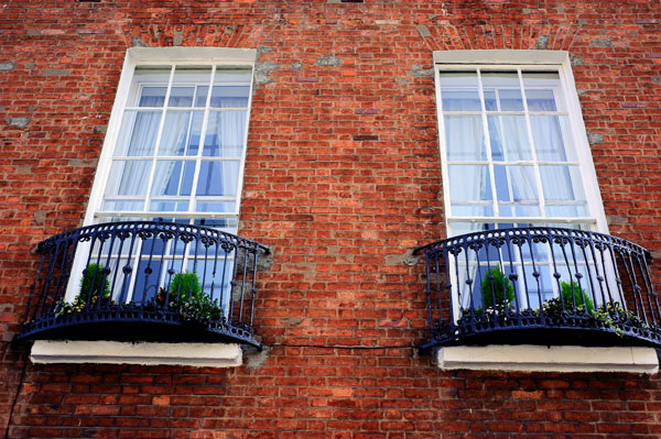 Twin Windows against a red brick surround