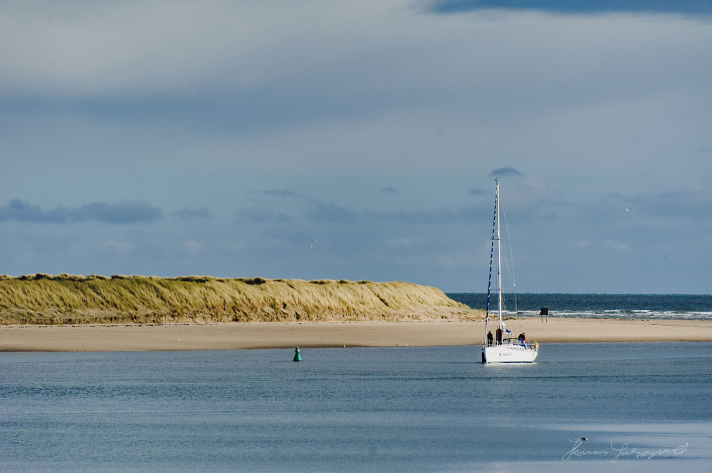 A Boat comes into the Estuary in Malahide