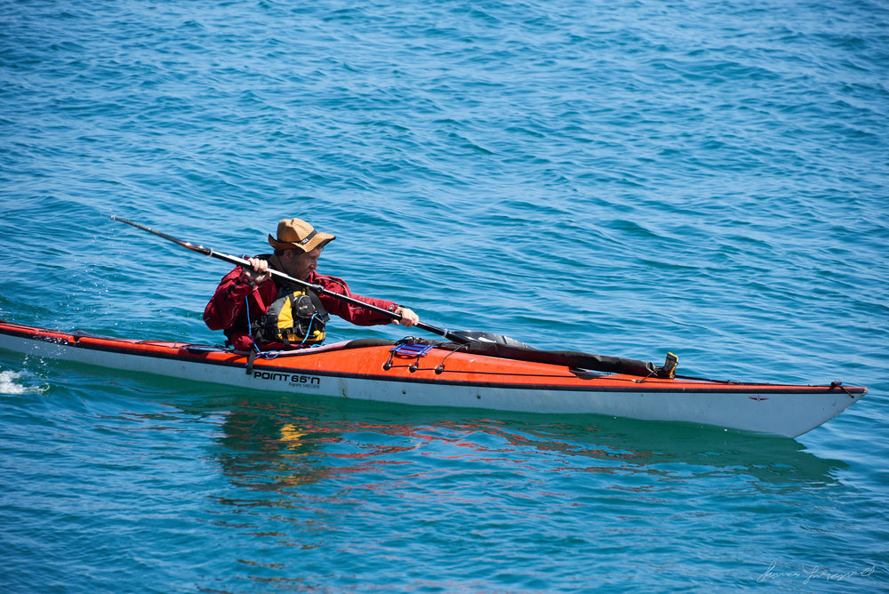 A canoeist in the blue waters on a sunny day in Dublin bay off the coast of Dalkey in Dublin