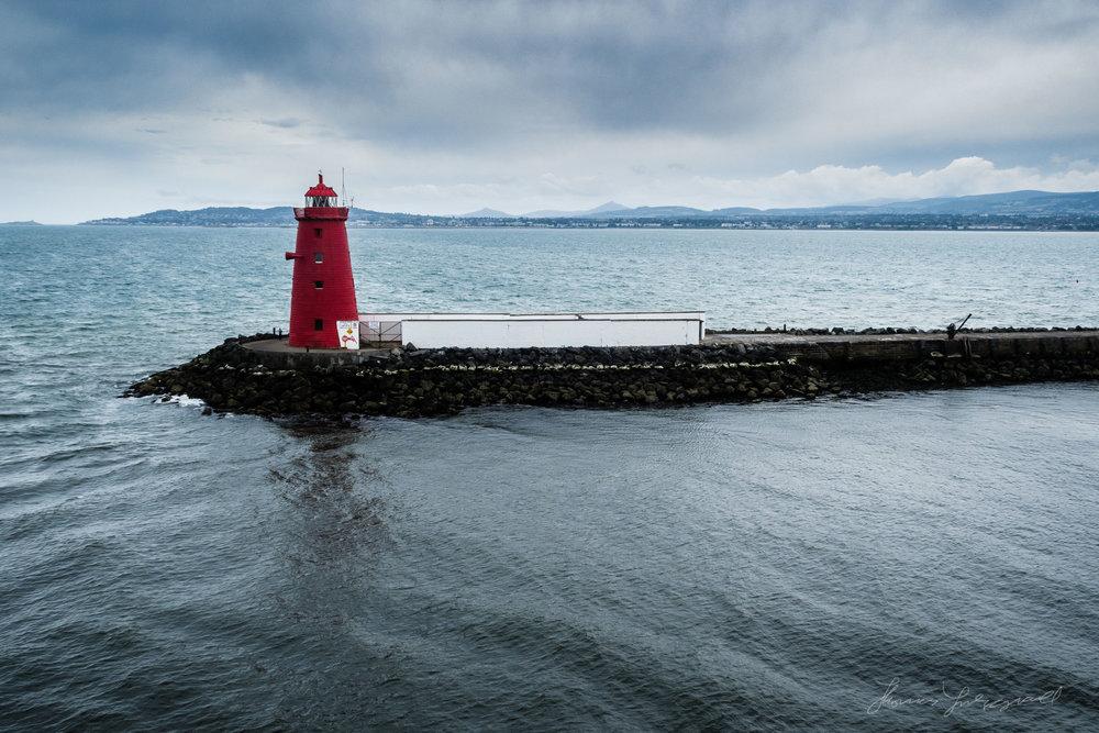 Red lightouse at the enterance to Dublin Bay