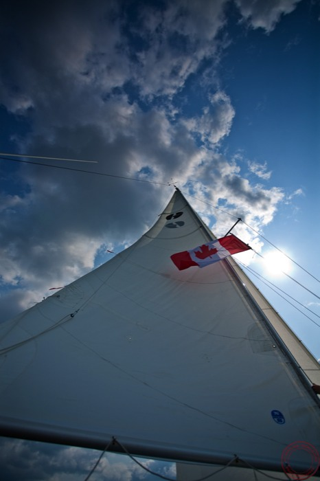 Sails, skies, and a Canadian flag