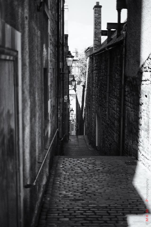 narrow stone street scotland photography