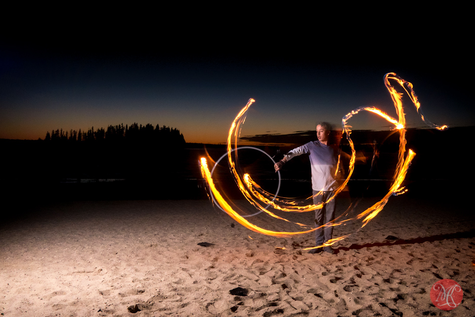 beach sunset fire performer