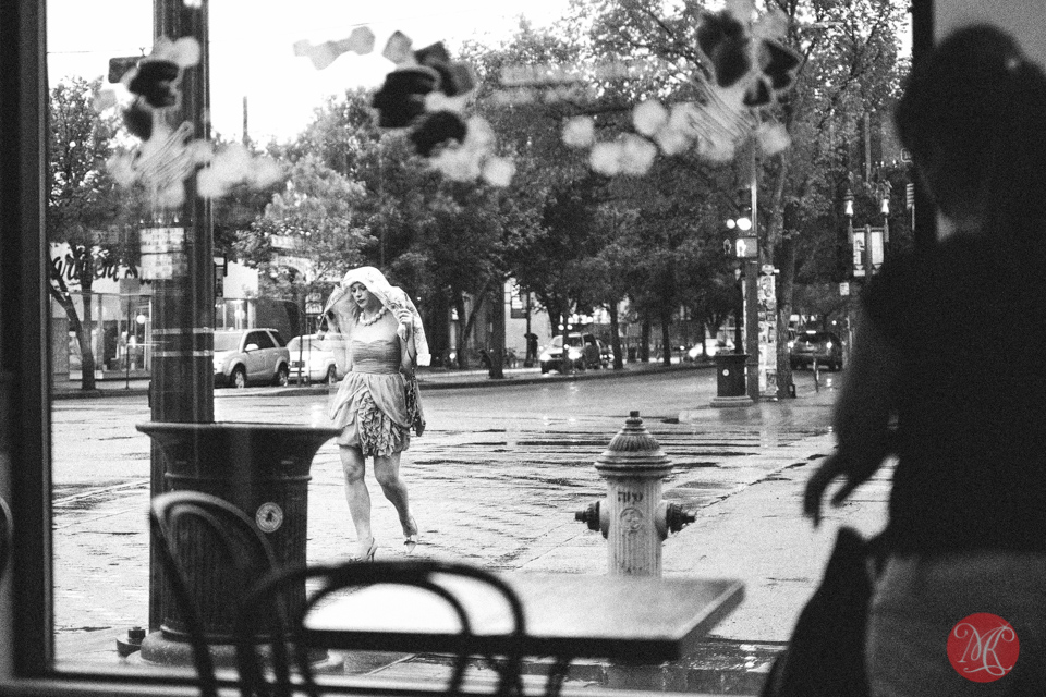 crossing street rain coffee street candid
