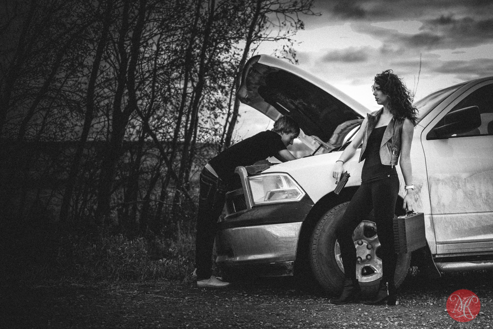 man woman broken truck alberta