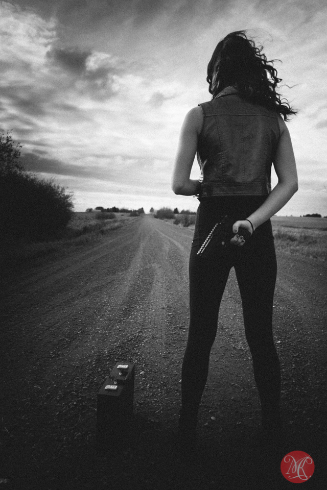 woman gun story alberta landscape