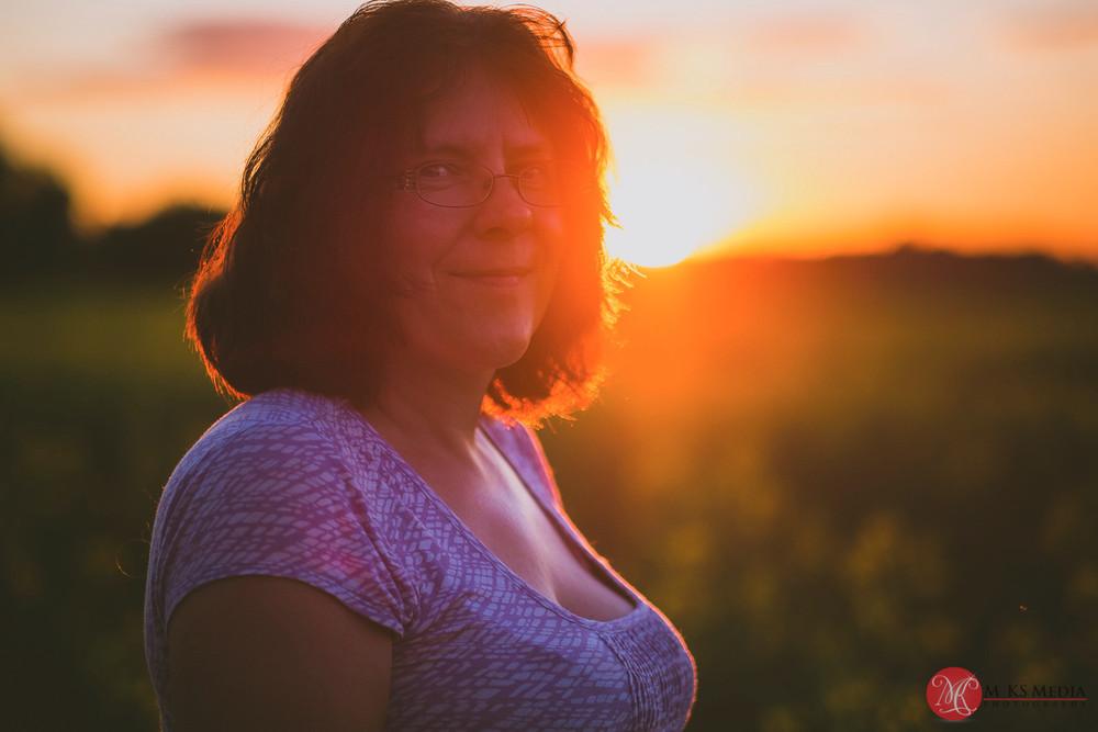 Alberta canola field sunset portrait of a woman