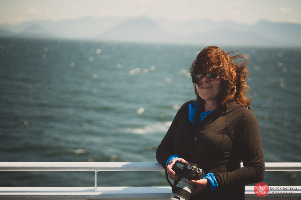 14 woman on ferry with wind blowing through hair.jpg