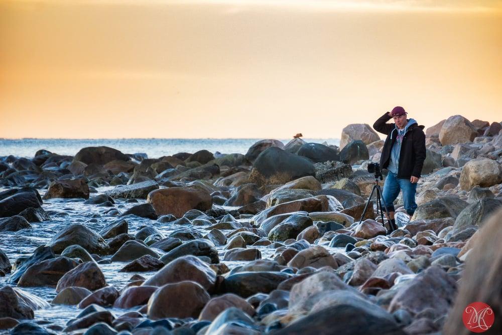 Photographer on beach at sunset