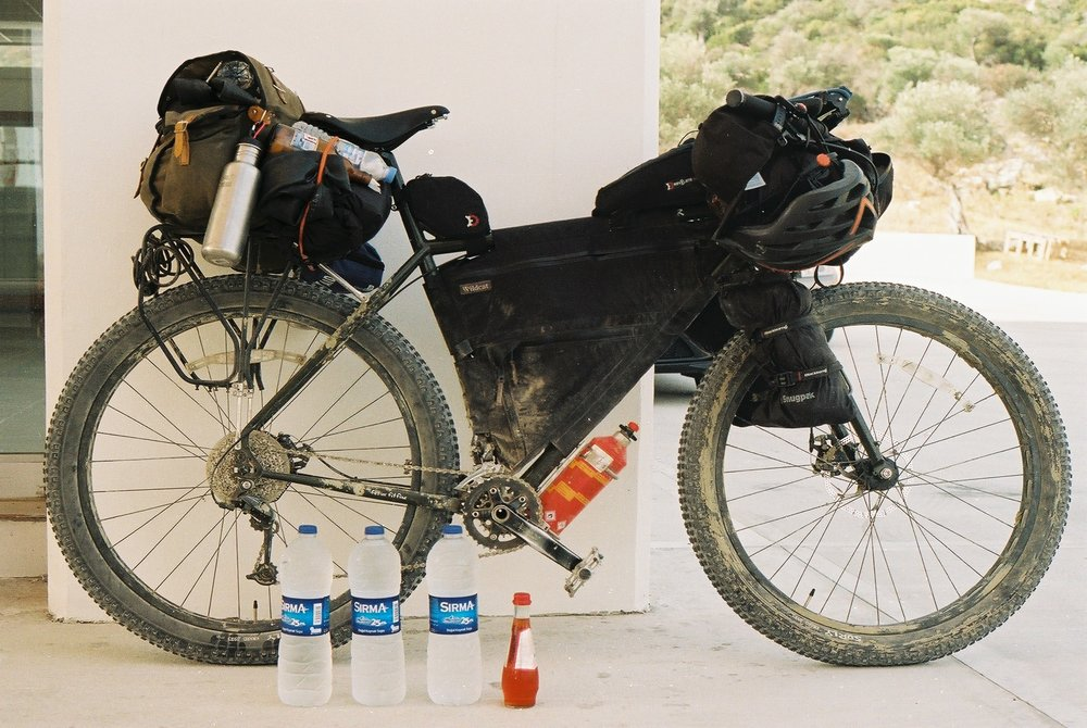 surly, surly ear, ear, surly bikes, 29er, mtb, mountain bike, bike packing blog, bicycle touring apocalypse, bikepacking cyprus, bikepacking greece, ecr, knards, revelate designs, carradice, trangia, film photography, jack macgowan, go north cyprus, canon ae1, water, keeping hydrated