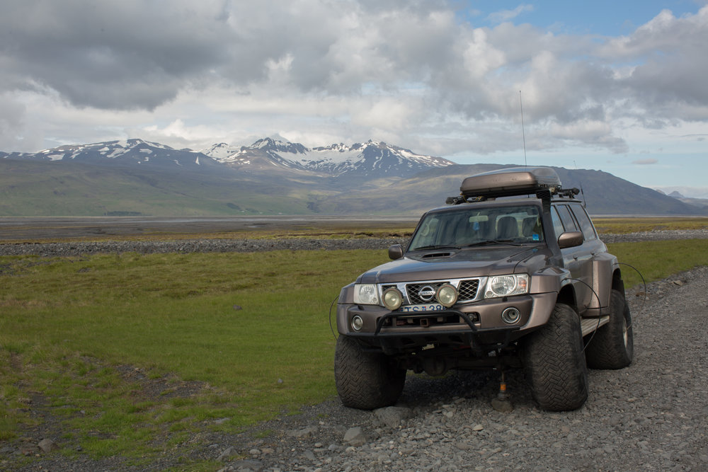 This Nissan had broken an axel and had been abandoned in the highlands .