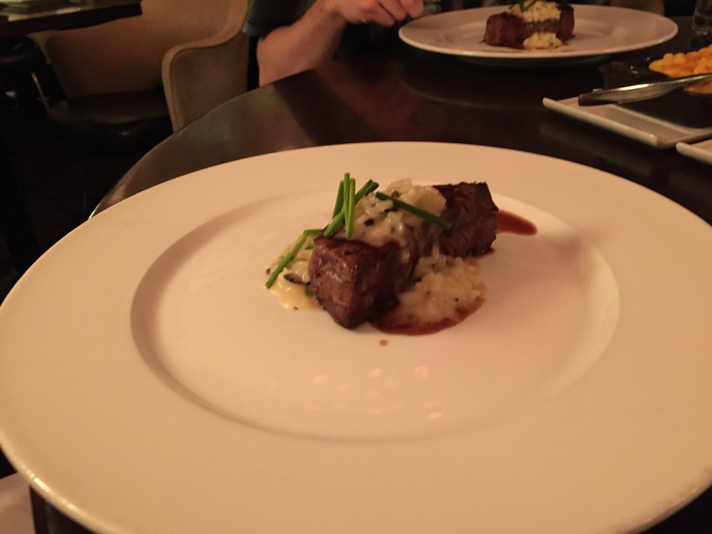 Filet of Wagyu beef served with truffle risotto and demi glace