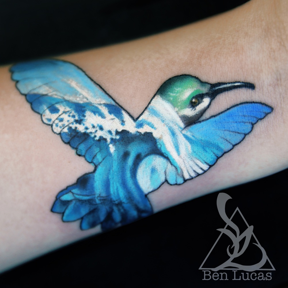 Hummingbird and tidal wave wrist tattoo