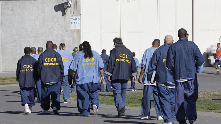 Inmates walk through the exercise yard at California State Prison Sacramento, near Folsom, Calif. (Rich Pedroncelli / Associated Press)