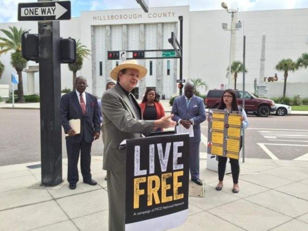 The Rev. Russell L. Meyer speaks in Tampa on Tuesday at a news conference for Live Free, a campaign by the PICO National Network to reduce incarceration rates in the country and in Hillsborough County. [Tony Marrero | Staff]
