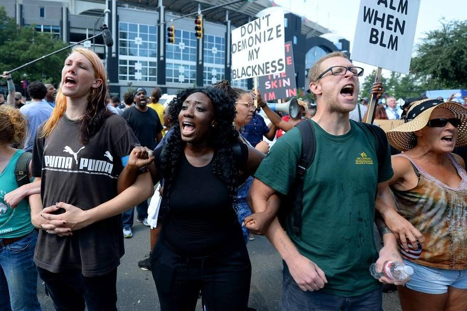 Protesters chant outside Bank of America Stadium in Charlotte, NC prior to the Carolina Panthers vs Minnesota Vikings NFL football game on Sunday. , September 25, 2016. Jeff Siner jsiner@charlotteobserver.com