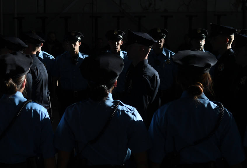 Police recruits walk in for their graduation at Denver Police Academy training facility, Jan. 6, 2017. RJ Sangosti, The Denver Pos