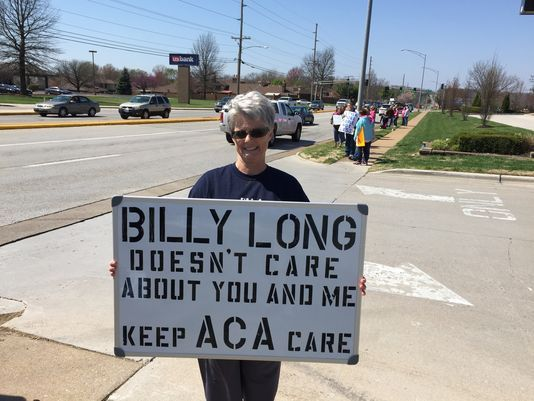Laura Umphenour holds her sign as part of a protest against U.S. Rep. Billy Long for his support of the proposed American Health Care Act on Thursday, March 23, 2017, in Springfield.(Photo: Will Schmitt/News-Leader)