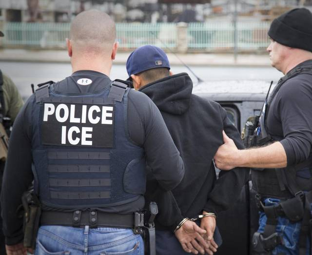 Immigration and Customs Enforcement agents make an arrest in Los Angeles in a February file photo. ICE agents detained 26 undocumented parolees reporting for community service Sunday morning at a Tarrant County facility on Cold Springs Road. Charles Reed Immigration and Customs Enforcement via AP