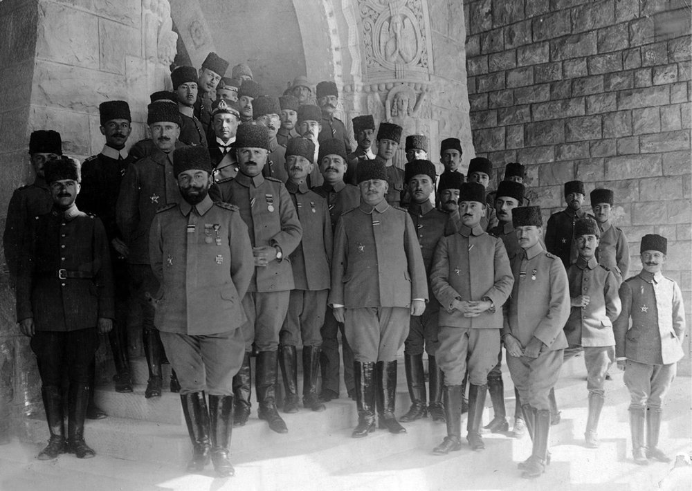 Cemal Pasha and his staff on the front steps of the Augusta Victoria Hospice in Jerusalem (notice the bas reliefs of angels in the background). Ali Fuad is seen on Cemal Pasha's right. The fifth officer from the right in the front row is Küçük Cemal Pasha. The young officer inclining his head in the back row is Falih Rıfkı. Iclal and Tunca Őrses Archive.