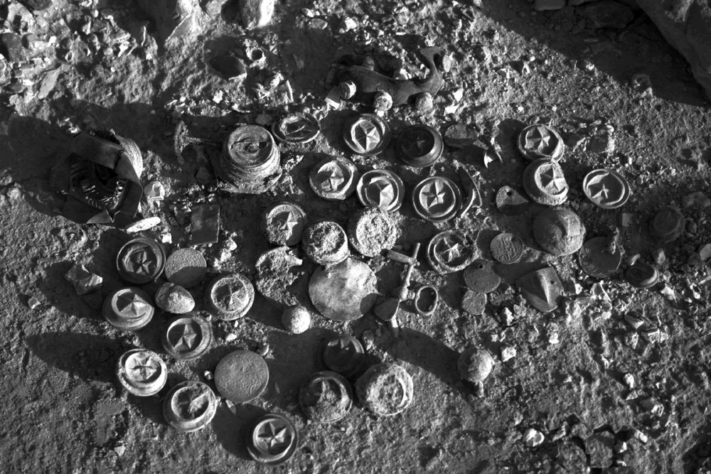 Ottoman remains in the Jordanian desert. Uniform buttons, a horse bridle bit, coins, seals. Courtesy of John Winterburn. Photograph from the GARP archives.