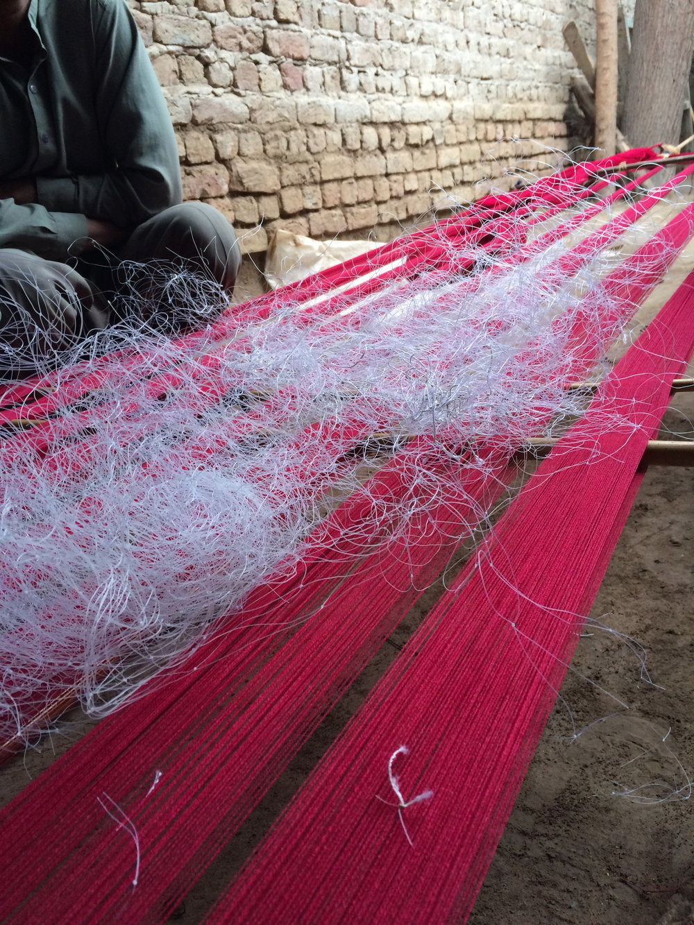 AMB village: discussing how to use ghost nets in weave