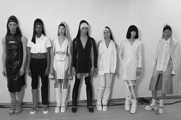 """Gender, for instance. It is women's fashion week, and Hood by Air's collection —""""Superego,""""to complement""""Ego,"""" the collection it showed during New York Fashion Week, and """"Id,"""" the one it will show at the Museum of Modern Art in New York in late October, a trifecta of enlarging ambition — was nominally women's wear. But only nominally (if even that). """"Ego"""" was more-or-less men's wear. """"Superego"""" was arguably for women, but the label prefers not to specify. Still, Mr. Oliver allowed, """"It's allowing us to open our market. The women's market is a thing.""""http://www.globefashionrunway.com/#/hood-by-air-ss2015/"""