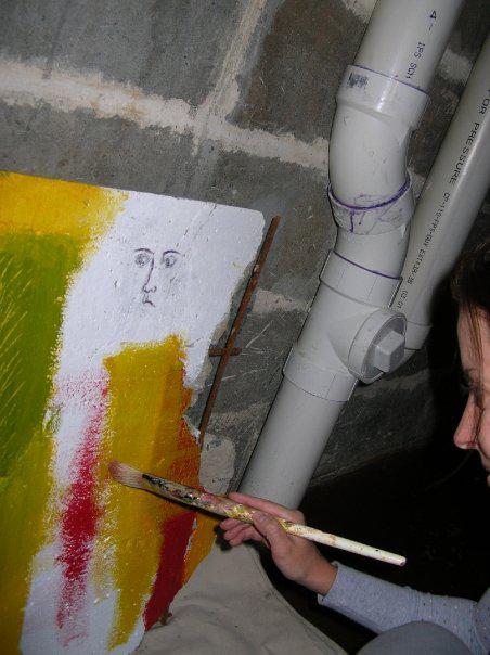 Joanne painting the Berlin Wall piece