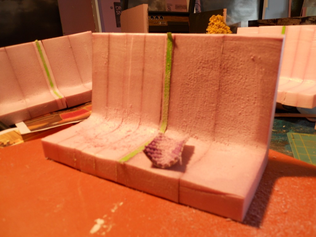 Subway seats-step 1. Glue together rough cut pieces of pink foam. Use hot-wire then sandpaper to shape.