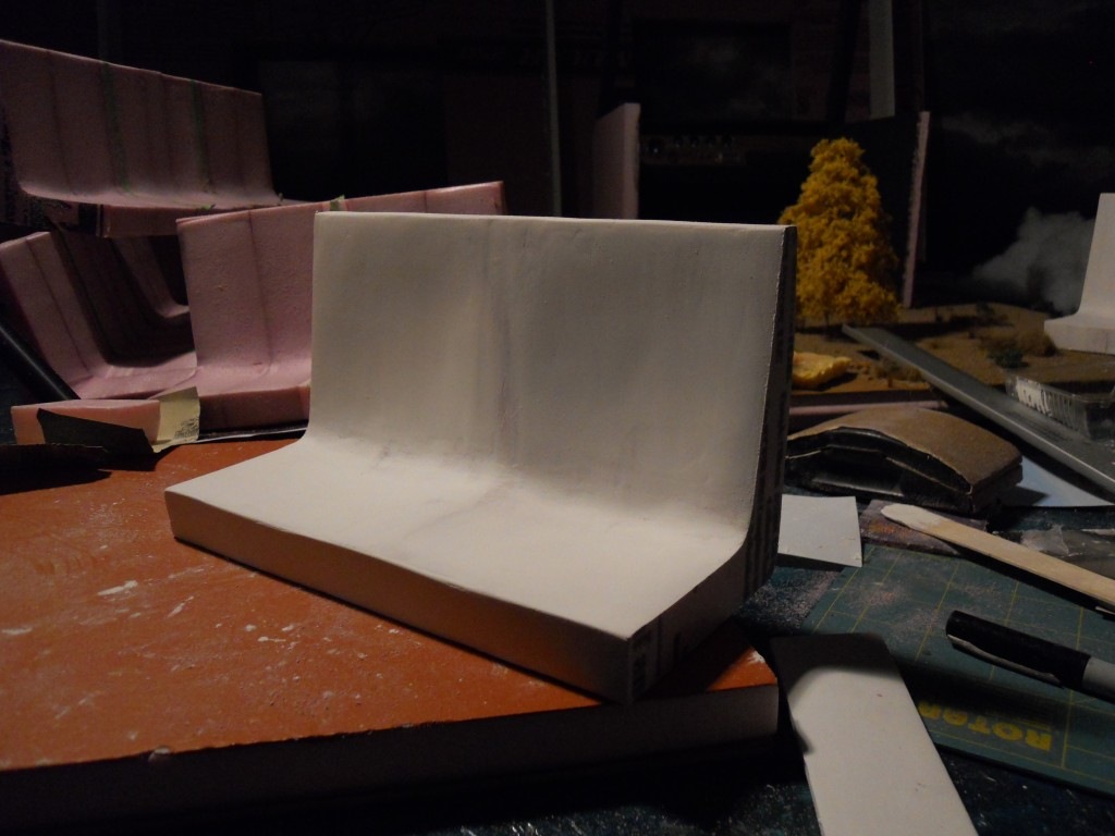 Subway seats -step 2. Cover seats with spackle then more sanding. Repeat 2-3 times as needed to get the desired shape.