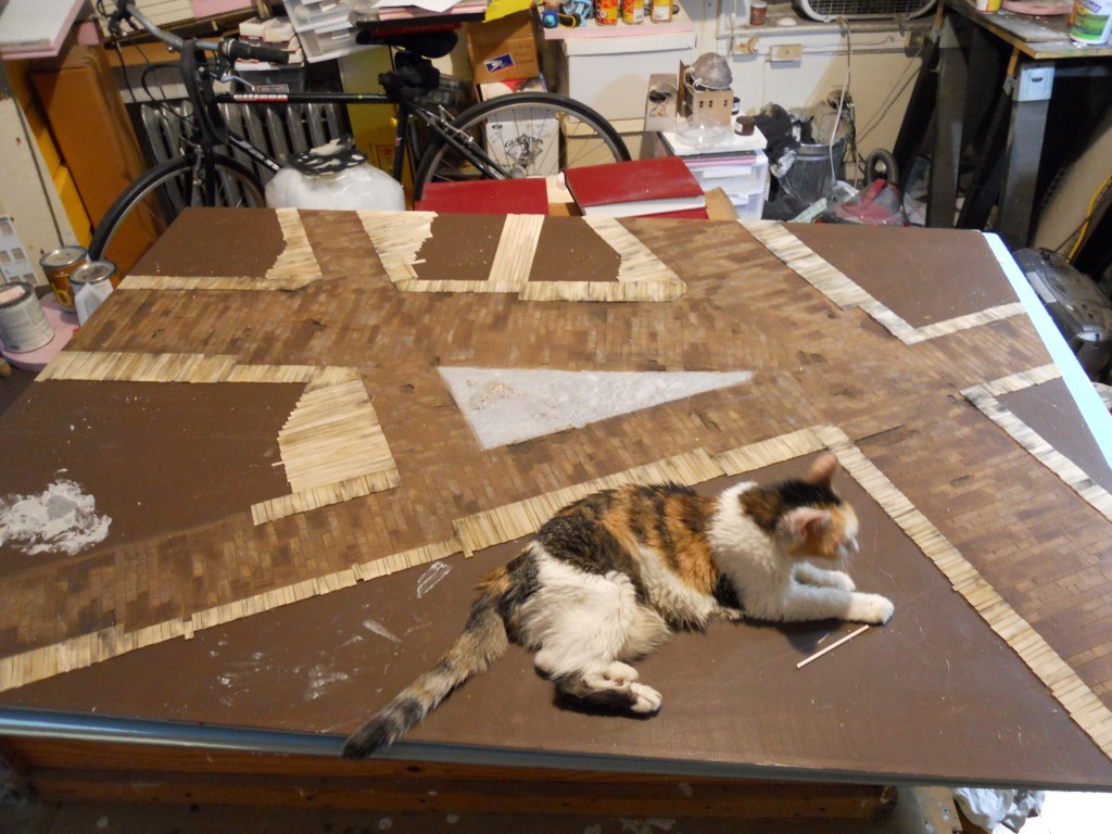 Laying out streets and wooden sidewalks for Five Points model. Daisy is keeping the board in place.