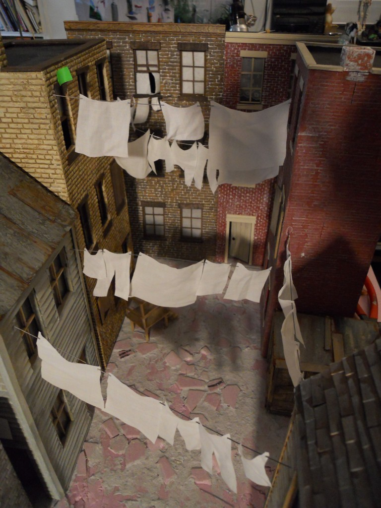 Birds-eye view of alley set up. Laundry is cut up dress shirt from the thrift store, hanging from piano wire.