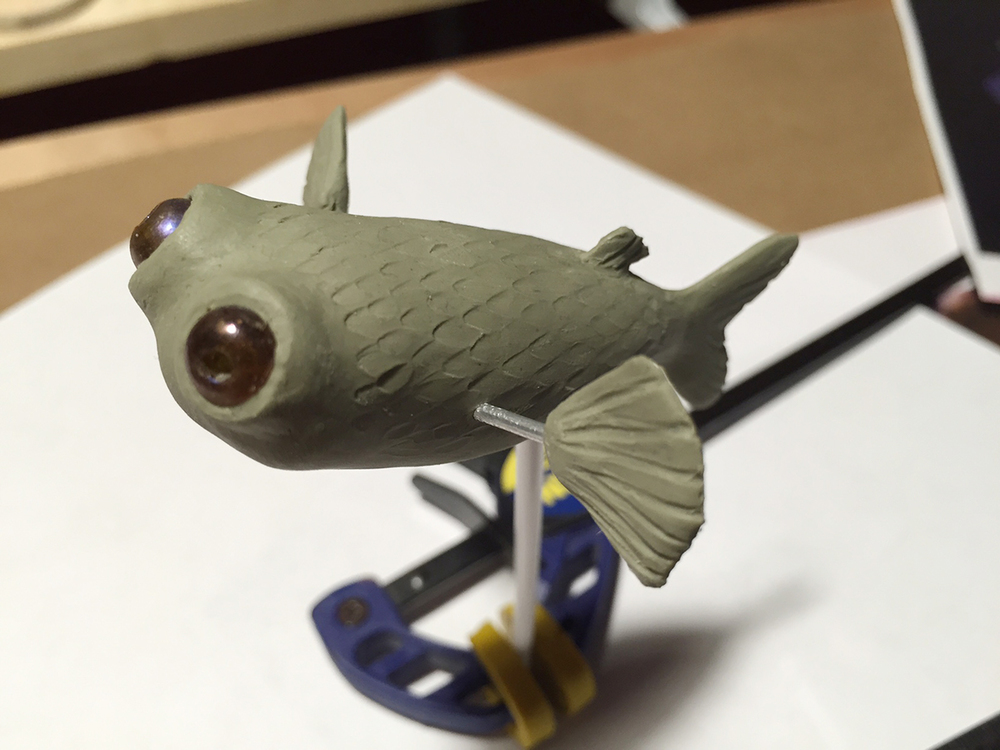 Fitting fins and eyes before casting.
