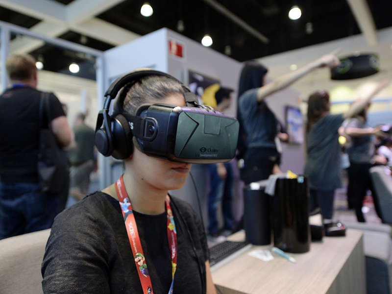 An attendee at the 2014 Electronic Entertainment Expo, in Los Angeles, California, tries out an Oculus VR headset kit.   (Photo: © KEVORK DJANSEZIAN/Reuters/Corbis)
